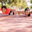 Girls doing pushups — Stock Photo #52643629