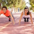 Girls doing pushups — Stock Photo #52643637
