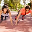 Girls doing pushups — Stock Photo #52643643