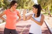 Runners showing off muscles — Stock Photo