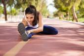 Woman stretching at running track — Stock Photo