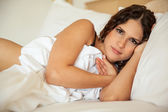 Sexy girl sleeping in her bed — Stock Photo