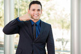 Businessman inviting customers to call — Stock Photo