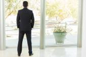 Businessman looking outside — Stock Photo
