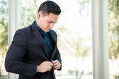 Businessman buttoning jacket — Stock Photo