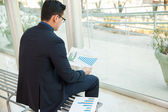 Businessman looking performance charts — Stock Photo