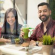 Couple enjoying smoothies — Stock Photo #65239031