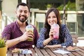 Couple enjoying  smoothies — Stock Photo
