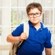 Little boy carrying a backpack — Stock Photo #67247687