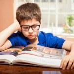 Boy  enjoying a good read — Stock Photo #67248075