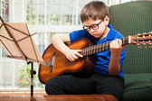 Kid practicing some guitar chords — Stock Photo