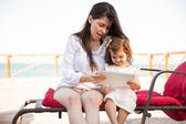 Mother and daughter using tablet — Stock Photo
