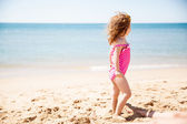 Little girl looking curiously at the ocean — Stock Photo