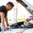Man looking at car with hood open — Stock Photo #71584717