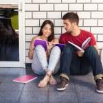 Students sitting outside — Stock Photo #72579577