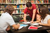 Tudent explaining  school work — Foto Stock