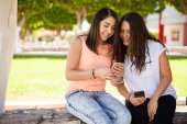 Cute girls looking at a smartphone — Stock Photo