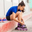 Woman putting her inline skates on — Stock Photo #73529819