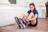 Woman putting her inline skates on — Stock Photo