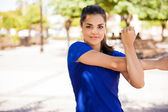 Young  girl stretching her arms — Stock Photo