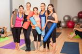 Women with exercise mats — Stock Photo