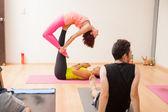 Women demonstrating yoga poses — Stock Photo