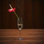 Red anthurium Flamingo flower Boy flower  in glass vase on woo — Stock Photo