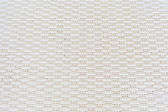 White cream plastic surface with repeating pattern. — Stock Photo