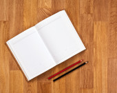 Blank notepad with office supplies on wooden table. — Stock Photo