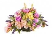 Bouquet from artificial flowers arrangement centerpiece in vase. — Stock Photo