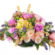 Bouquet from artificial flowers arrangement centerpiece in vase. — Stock Photo #54088755