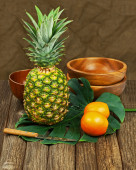 Still Life with Pineapple and Oranges on Wooden background.  — Stock Photo