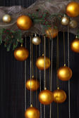 Christmas Balls and Spruce Branches with Cones on Natural Backgr — Stock Photo
