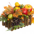 Composition from Artificial Fruits and Autumn Leaves in Wooden Box — Stock Photo #58773833