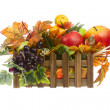 Composition from Artificial Fruits and Autumn Leaves in Wooden B — Stock Photo #58773955