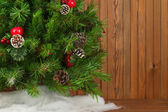 Fragment of Green Decorated Christmas Tree on Wooden Background. — Stockfoto