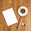 Blank notepad with office supplies and cup of coffee on wooden t — Stock Photo #59546687