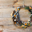 Green Christmas Wreath with Decorations on Wooden Background. — Stock Photo #59548339