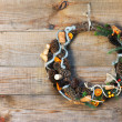 Green Christmas Wreath with Decorations on Wooden Background. — Stock Photo #60293243