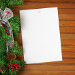 Garland with Christmas ornaments, pine cones and sheet of paper. — Stock Photo #60294497