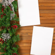 Garland with Christmas ornaments, pine cones and sheets of paper — Stock Photo #60294515