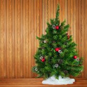 Green Decorated Christmas Tree on Wooden Background. — Stock Photo