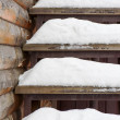 Powdery snow covered old wooden stairs.  — Stock Photo #60567249