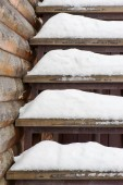 Powdery snow covered old wooden stairs.  — Stock Photo