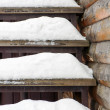 Powdery snow covered old wooden stairs. — Stock Photo #61958679