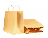 Empty brown recycled paper shopping bags isolated on white backg — Stock Photo