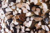 Woodpile from dry oak logs. Selective focus. — Stock Photo
