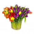 Flower bouquet from colorful tulips in glass vase isolated. — Stock Photo #67400965