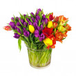 Flower bouquet from colorful tulips in glass vase isolated. — Stock Photo #67480391