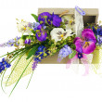 Bouquet from artificial flowers arrangement centerpiece in woode — Stock Photo #67617561